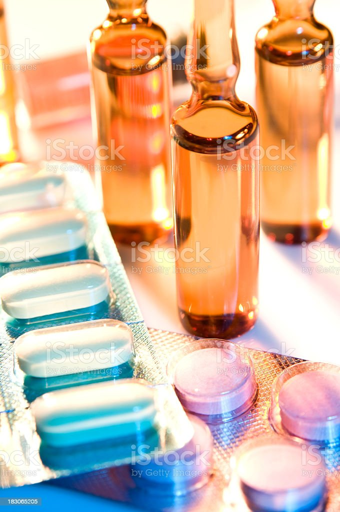 Close up of assorted pill packs and measuring devices royalty-free stock photo