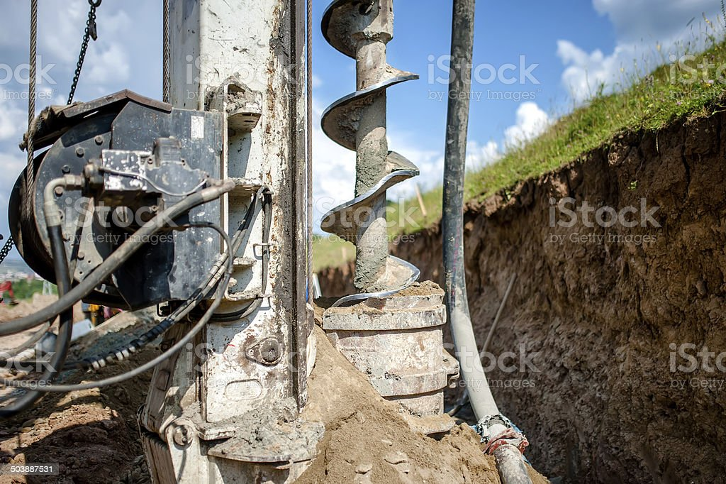 Close up of auger, industrial drilling rig making holes stock photo