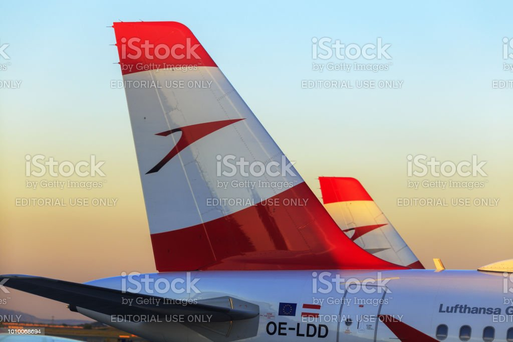 Close up of Austrian Airlines' airplanes with red logo and aircraft liveries in Vienna International Airport stock photo