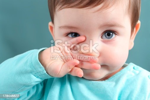 istock Close up of baby looking at camera with blue eyes 178448822