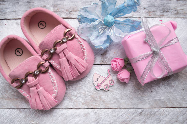 Close up of baby shoes on a wood background stock photo