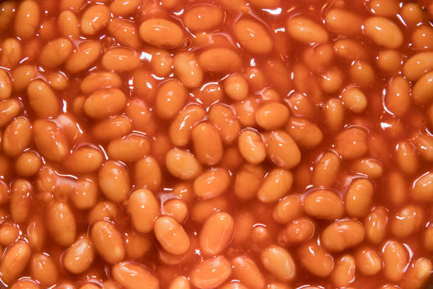 Close up of baked beans in a pan stock photo