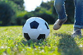 istock Close up of ball lying in grass 936966692