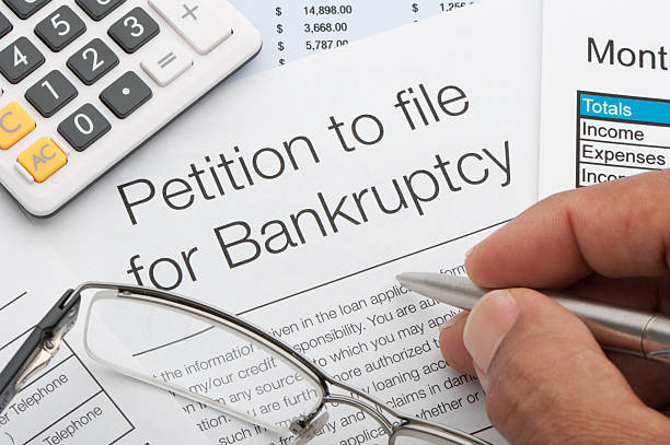 close up of bankruptcy petition - bankruptcy stock pictures, royalty-free photos & images