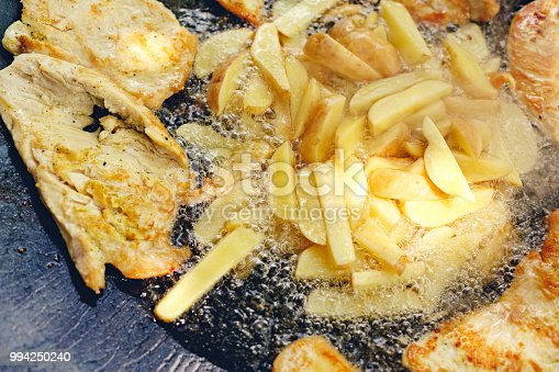 646207652istockphoto Close up of barbecue grill with various kinds of meat with potato for party 994250240