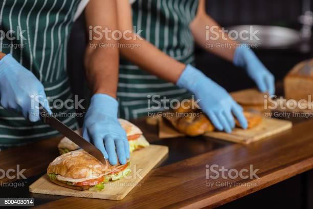 Close up of baristas preparing sandwiches picture id800403014?b=1&k=6&m=800403014&s=612x612&h=uud3 gd32bwz3qvvyteesmdo4og5kyzmljwaahfihjg=