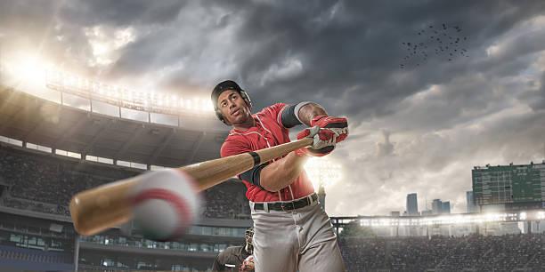 Close Up of Baseball Player Hitting Ball stock photo