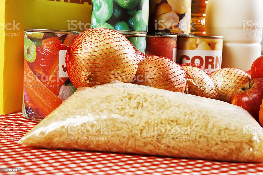 Close up of basic foods, rice in foreground, on cloth royalty-free stock photo