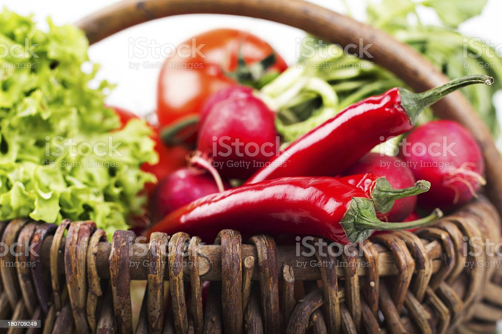 Close up of basket with fresh vegetables royalty-free stock photo