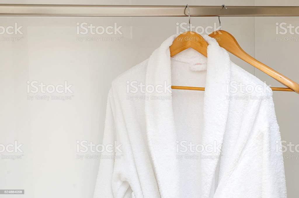 Close up of bathrobe in wardrobe background stock photo