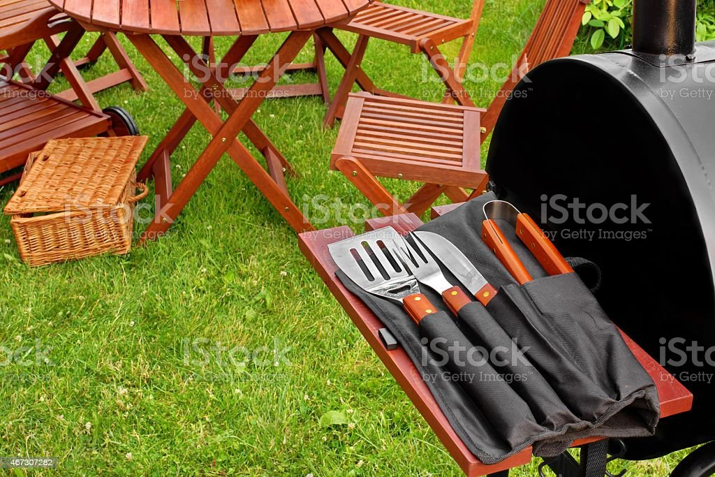Close up of BBQ utensils at a garden party stock photo