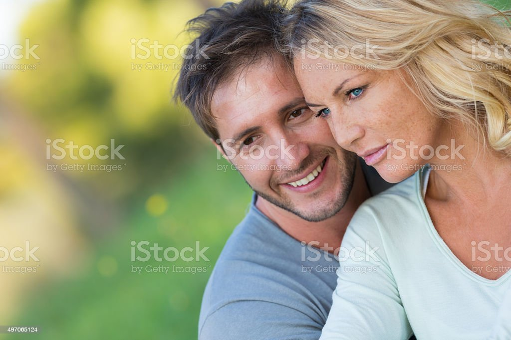 Close up of beautiful couple sitting in the nature stock photo