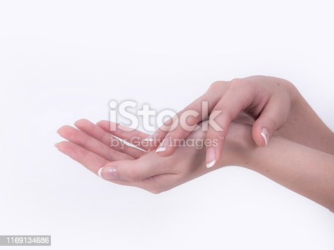 1151624350istockphoto Close up of beautiful Woman Hands. Spa and Manicure concept. Female hands with french manicure. Soft skin, skincare concept. Beauty nails. over beige background 1169134686