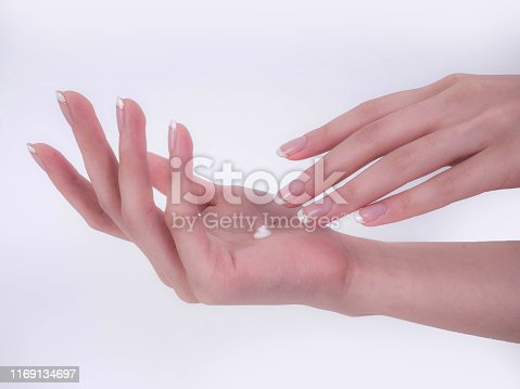 1151624350istockphoto Close up of beautiful Woman Hands. Spa and Manicure concept. Female hands with french manicure. Soft skin, skincare concept. Beauty nails. over beige background 1169134697