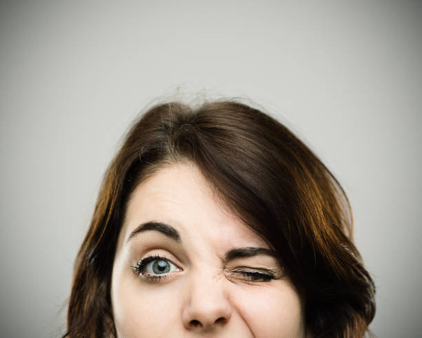 close up of beautiful young woman winking - funny fat lady stock photos and pictures