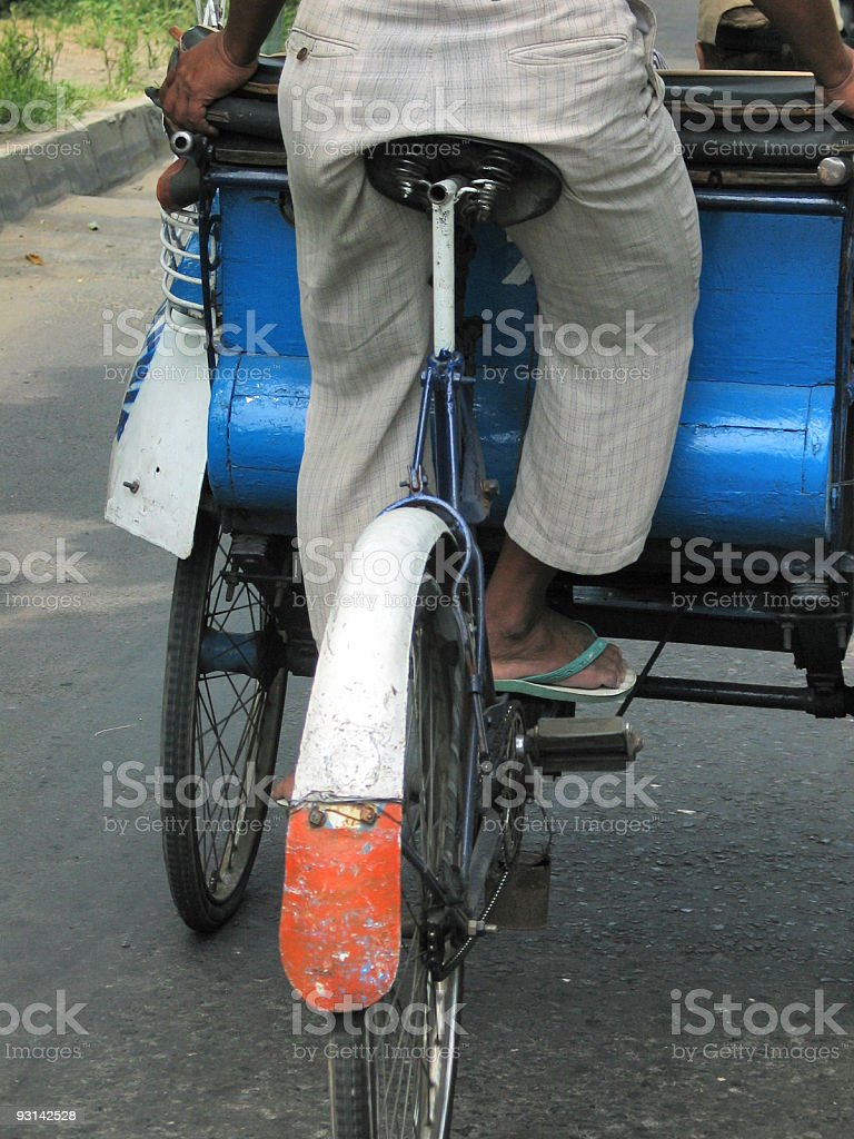 Close up of Becak bicycle driver in Indonesia royalty-free stock photo