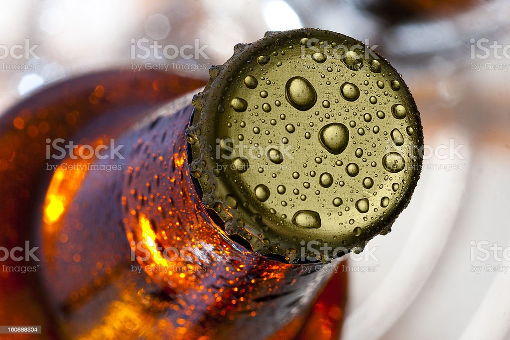 Close up of beer bottle cap covered with condensation stock photo
