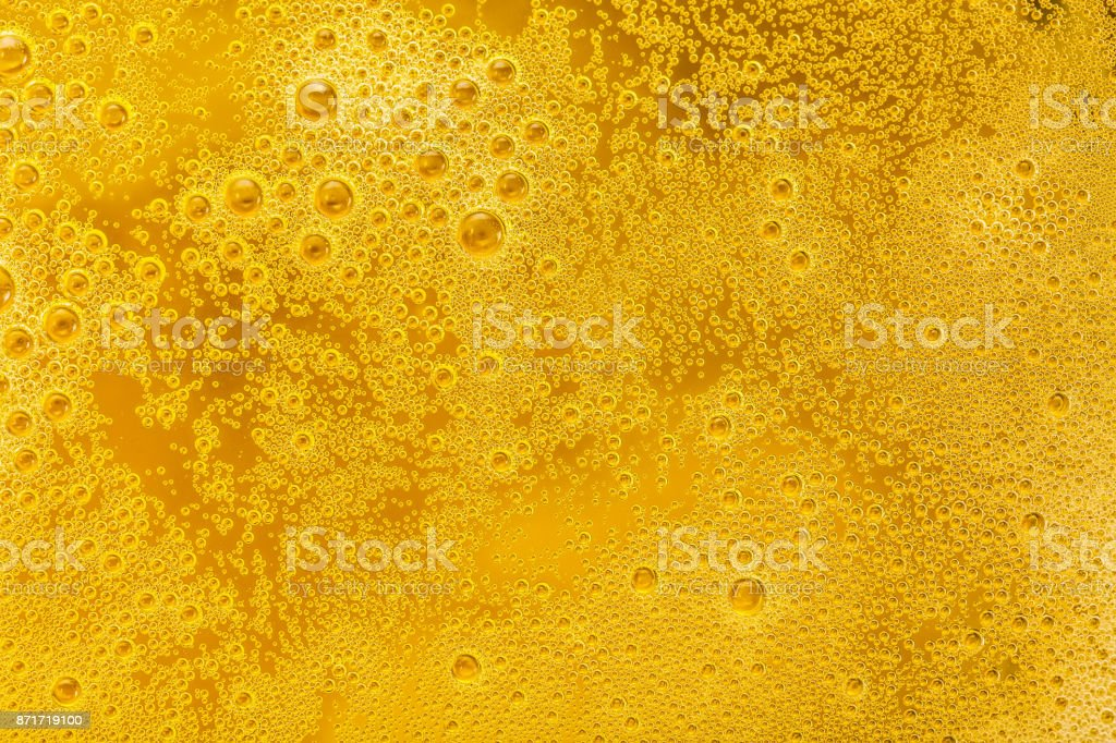 Close up of beer bubbles and foam as a background stock photo