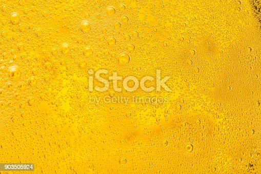 Close up of beer bubbles and foam as a background.