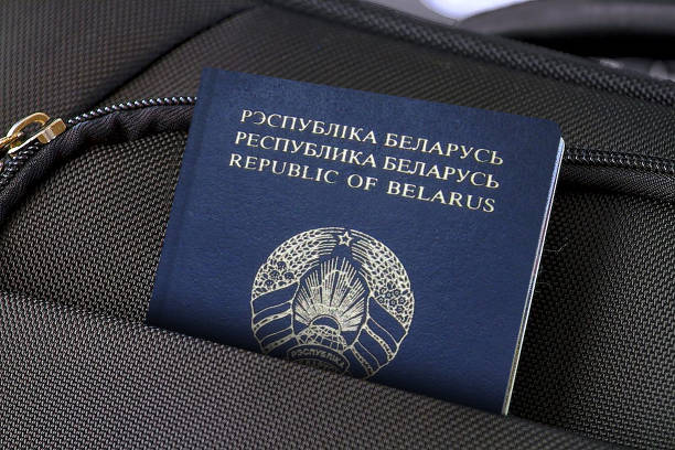 Close up of Belarus Passport in Black Suitcase Pocket Photo of a single suitcase made of fabric material and one passport in pocket. belarus stock pictures, royalty-free photos & images