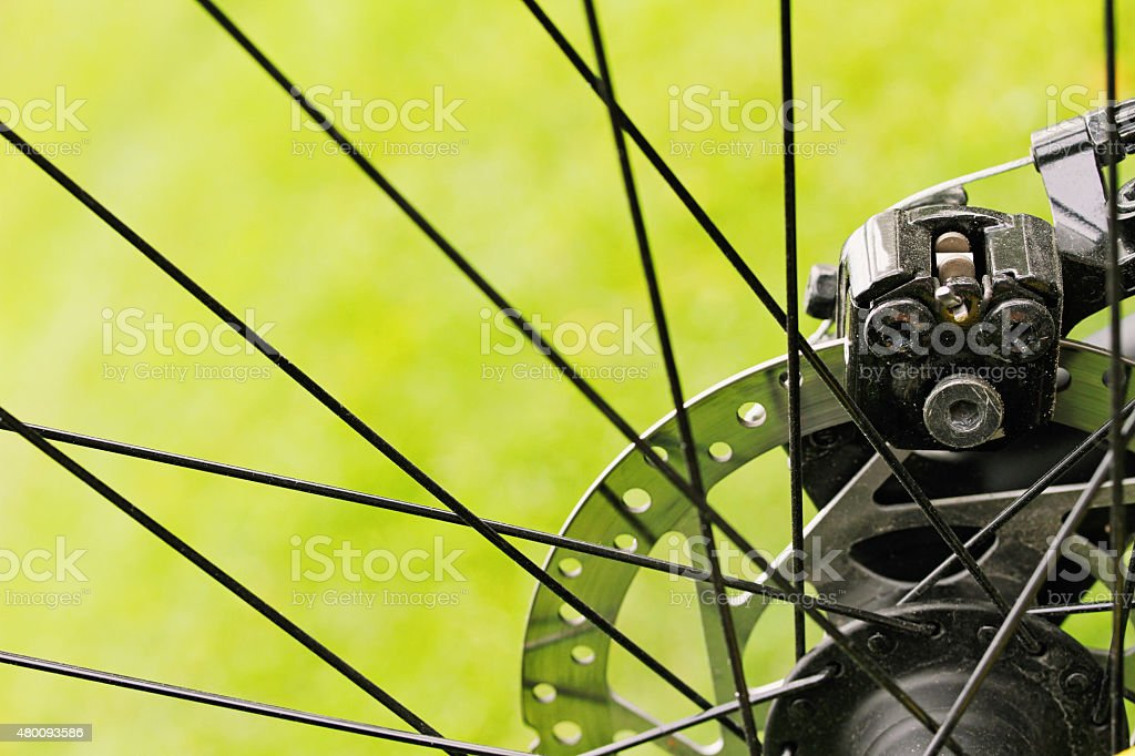close up of bicycle disc brakes stock photo