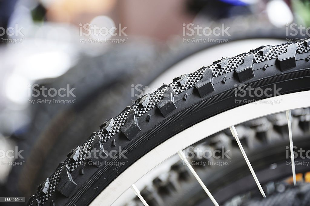 Close up of bicycle tyre, bikes in background royalty-free stock photo