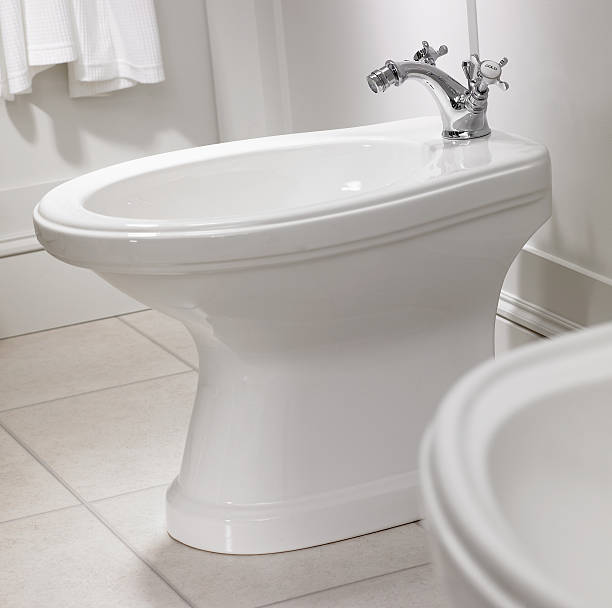 Close up of bidet in bathroom stock photo