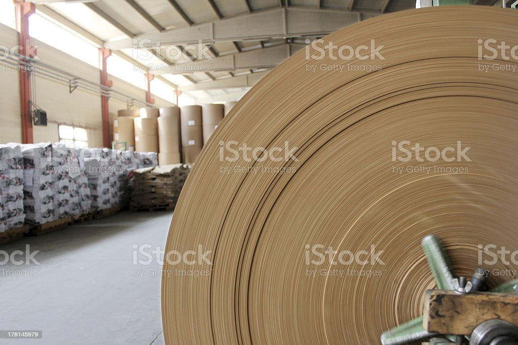 Close up of big roll of parchment paper inside warehouse royalty-free stock photo