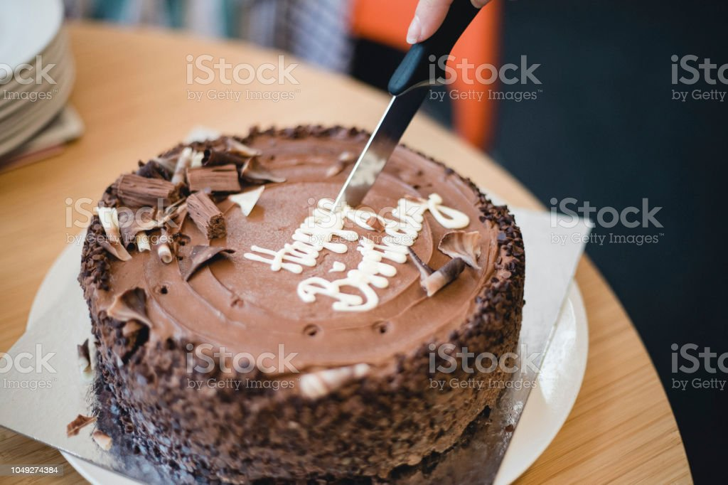 Close Up Of Birthday Cake Being Cut Into Slices Royalty Free Stock Photo