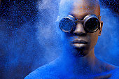 istock close up of black man covered with blue pigment 158865970