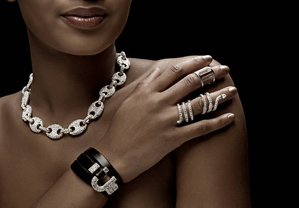 close up of black woman wearing luxury silver jewellery stock photo