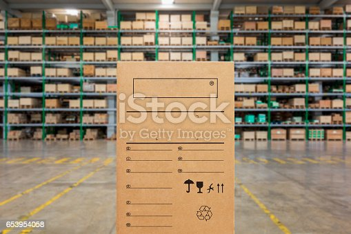 istock Close up of blank cardboard boxes inside large warehouse 653954058