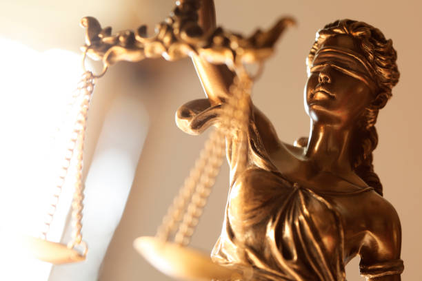 Close Up Of Blindfolded Lady Of Justice A close up of the head of the blindfolded Lady Justice. lawsuit stock pictures, royalty-free photos & images