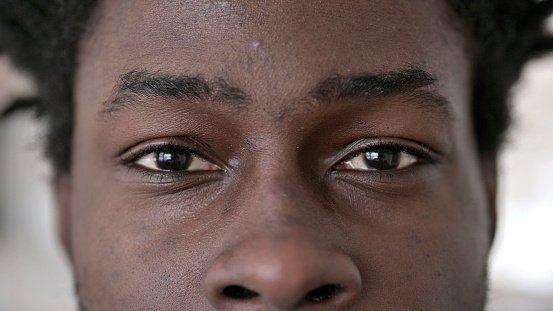 Close up of Blinking Eyes of African Man