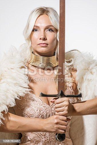 Close up of blonde viking warrior female in studio shot