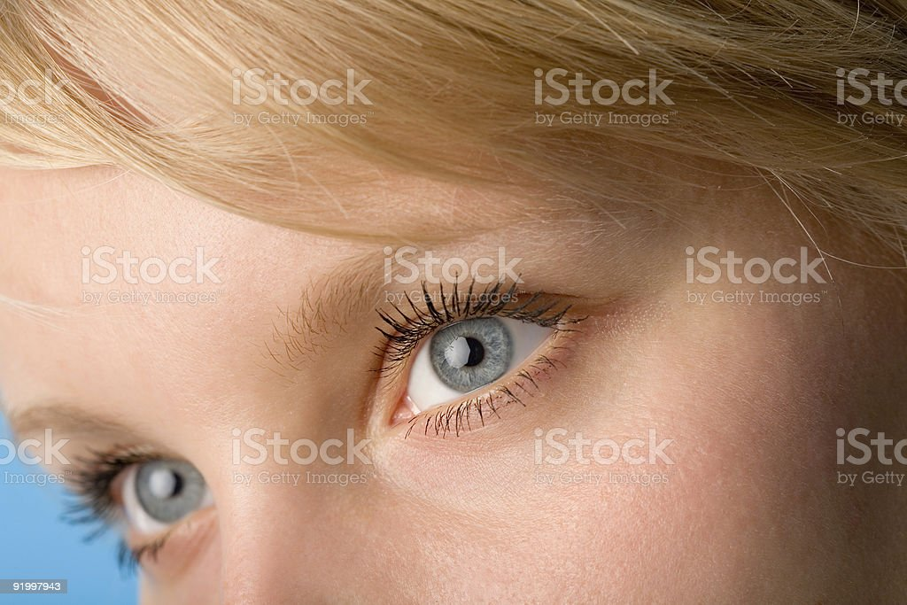 Close up of blonde woman with blue-grey eyes stock photo