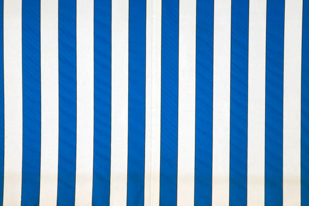 Close up of blue and white striped canvas. stock photo
