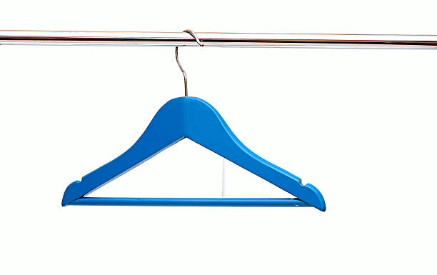 close up of blue cloth hangers in row stock photo