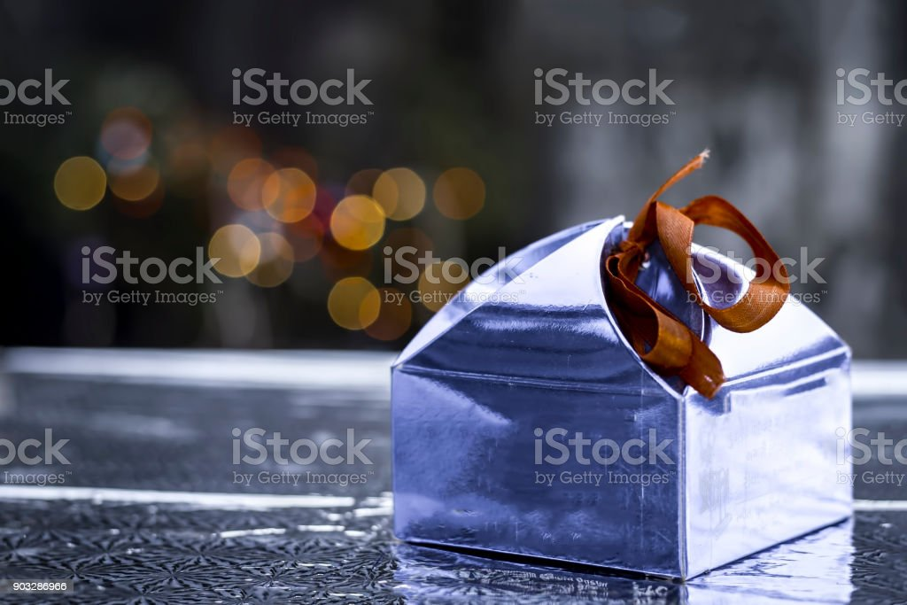 Close up of Blue gift box with red ribbon.Concept of Greeting with Best Wishes. stock photo