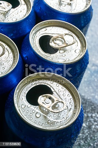 istock Close up of blue soda cans with open pull tab 1151539630