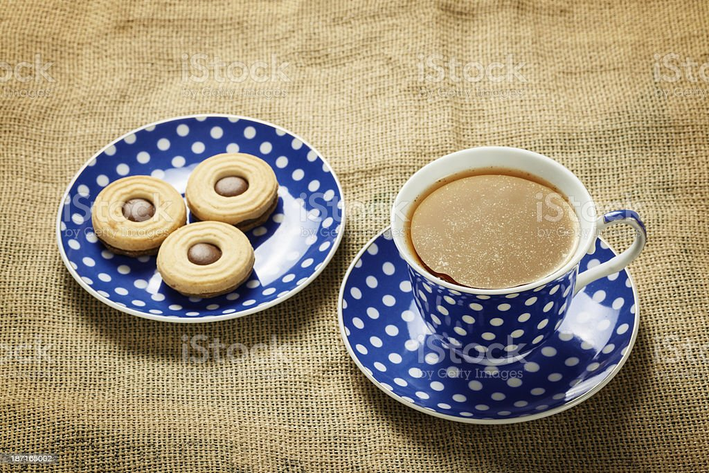 Close up of blue tea cup and cookies royalty-free stock photo