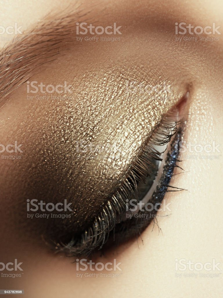 Close Up Of Blue Woman Eye With Beautiful Brown With Red And Orange