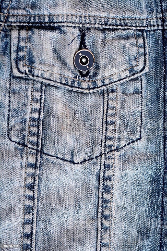 Close up of blue worn stone washed torn denim jacket stock photo