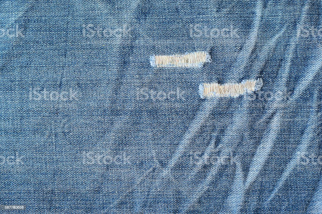 Close up of blue worn stone washed torn denim jeans stock photo