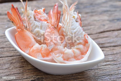 Close up of boiled shrimps on wooden table