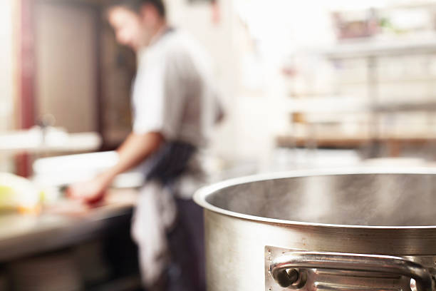 close up of boiling pot in kitchen - selective focus stock photos and pictures