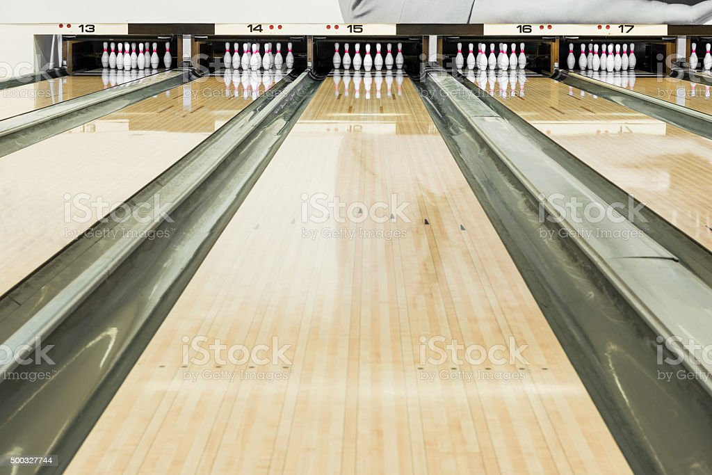 Close up of bowling pins in a row stock photo