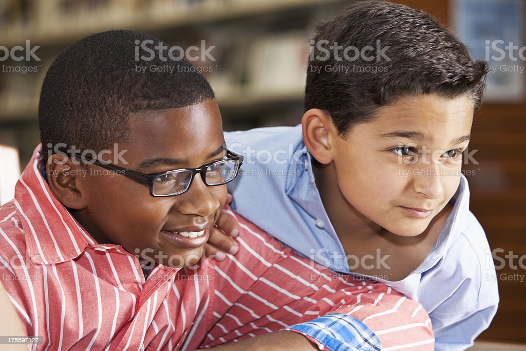 Close up of boys in library stock photo