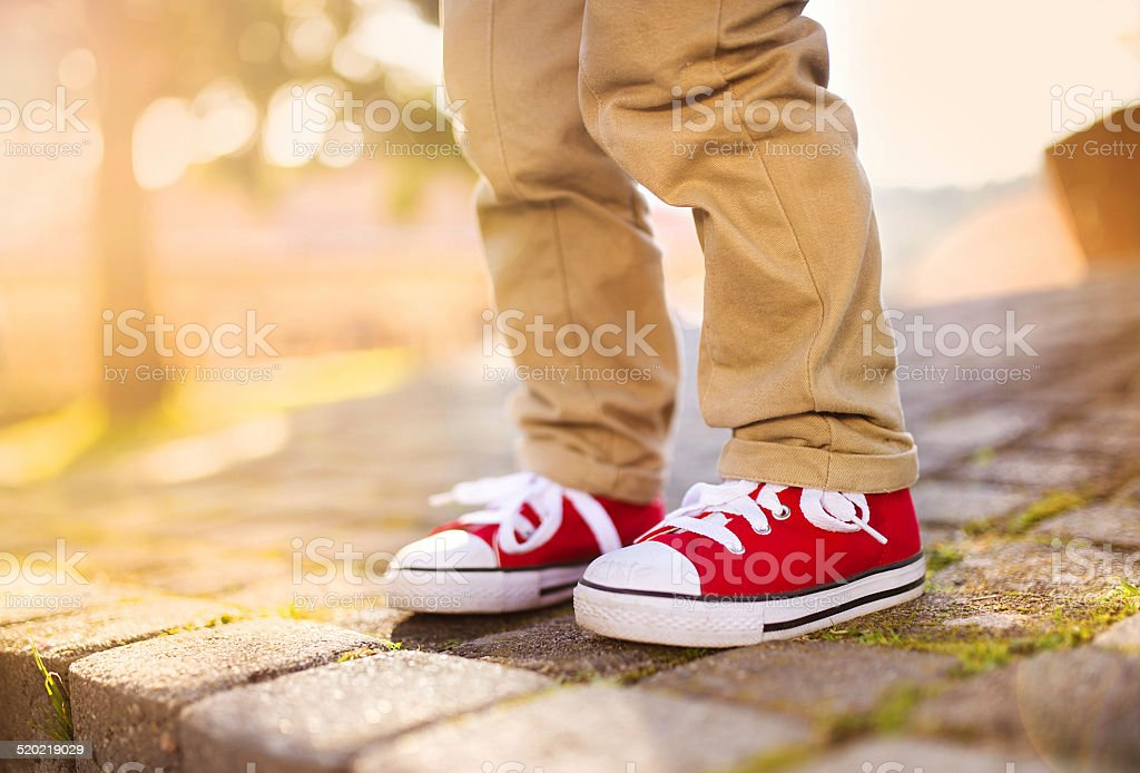 Close up of boy's legs stock photo
