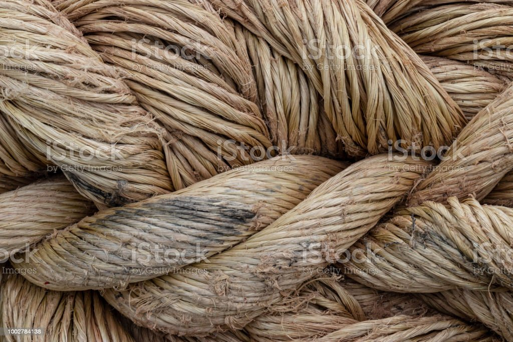 A close up of braided natural fiber brown rope. stock photo